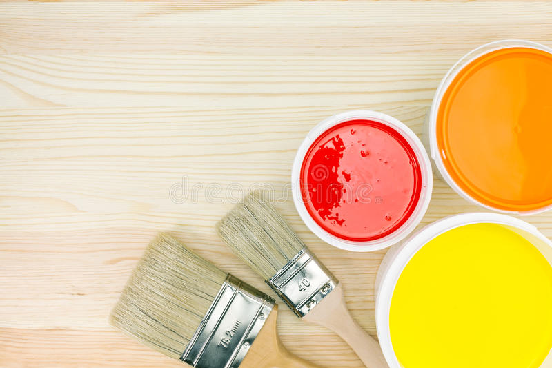 Paintbrushes and opened paint cans royalty free stock photo