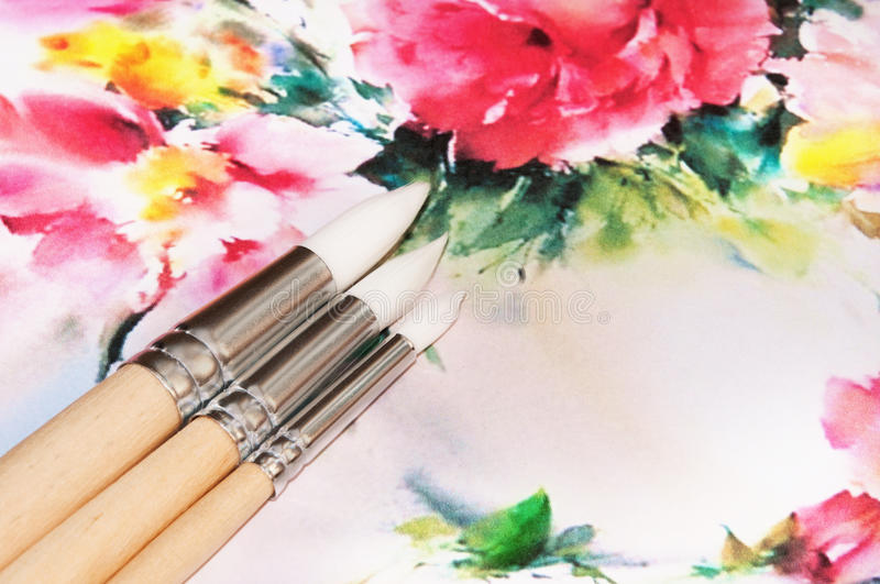 Paintbrushes over the paint background. royalty free stock photos