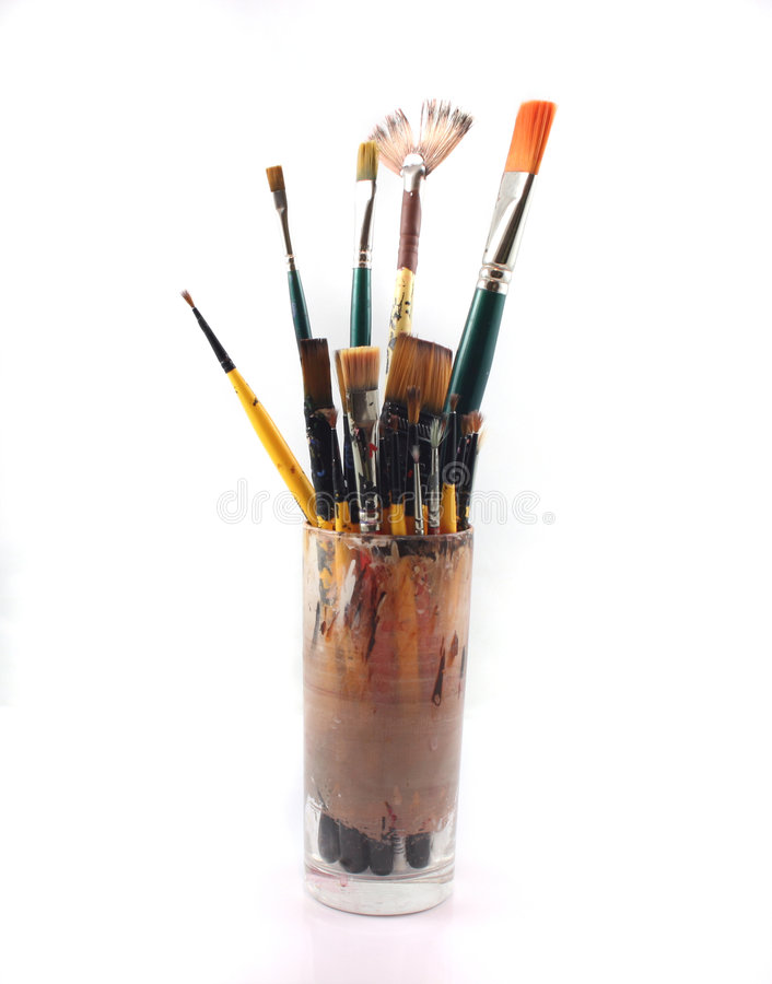 PaintBrushes on a white Background. Paint brushes in a glass on a white Background royalty free stock photos