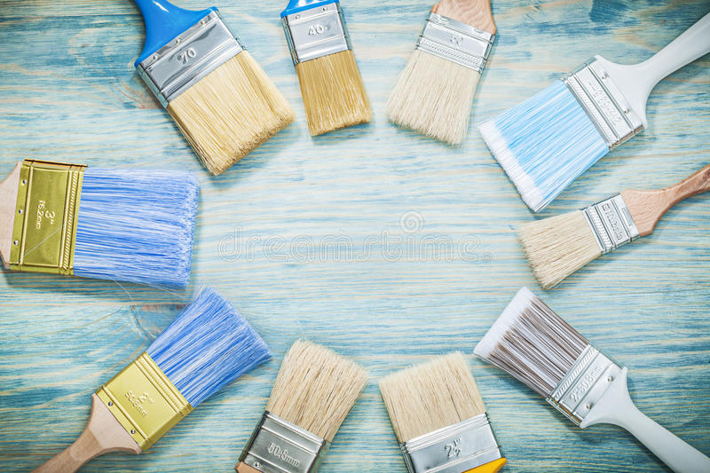 Paintbrushes on wooden board construction concept.  stock photo
