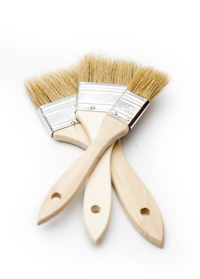 Paintbrushs simples em um fundo branco fotografia de stock