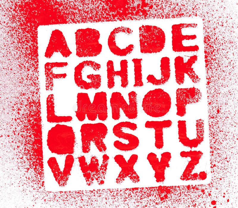 Painted Alphabet. A stenciled out set of the alphabet shot on white paper with lots of red spatter stock photography