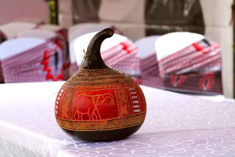 A painted artistically crafted guard used as a decorative item in an African wedding ceremony royalty free stock photos