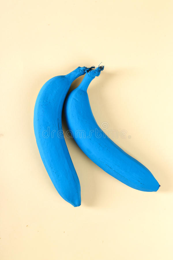 Painted banana. Design. Painted banana on the table stock photos