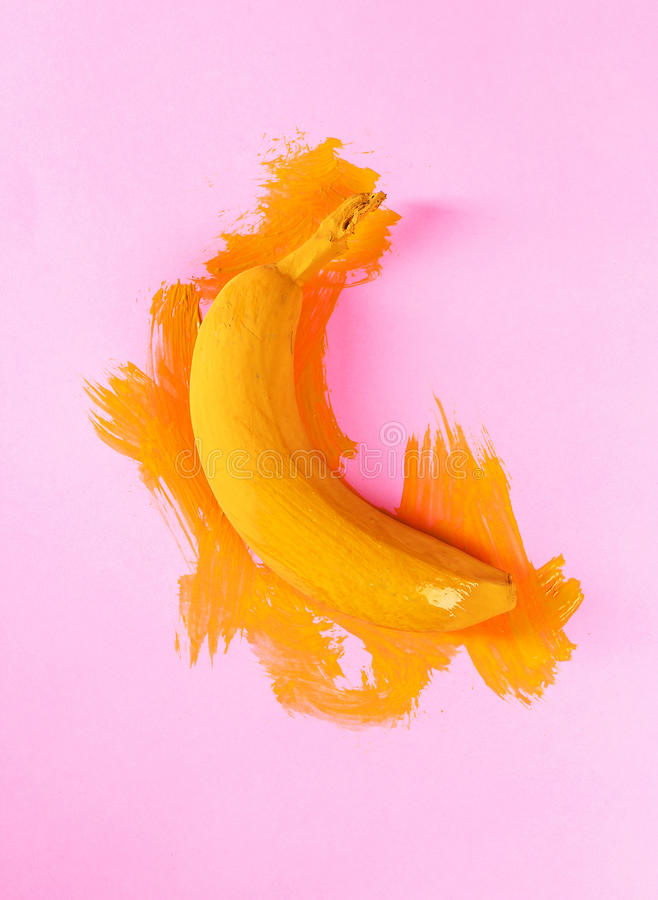 Painted banana. Design. Painted banana on the table stock images