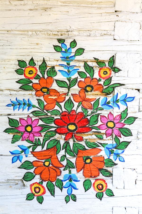 Painted beautiful floral pattern on the facade of an old house, Zalipie, Poland. royalty free stock images