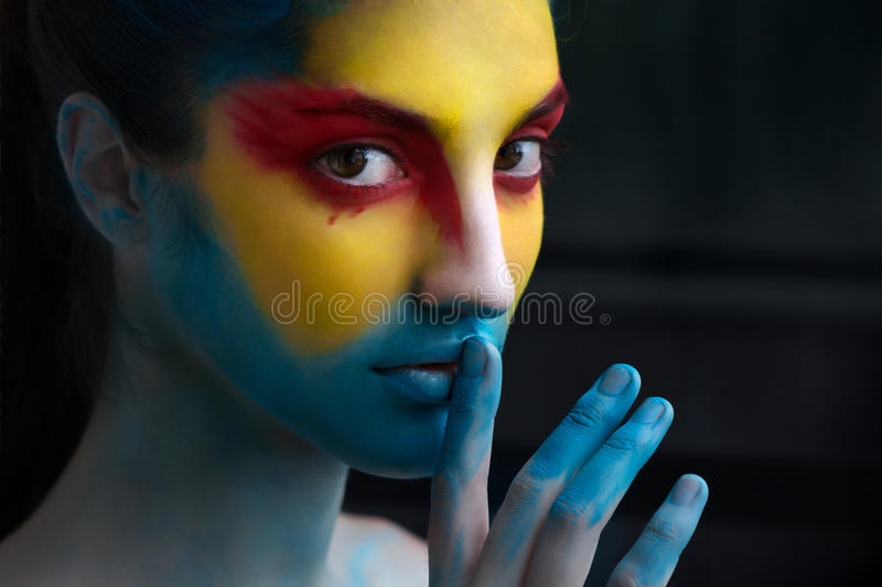 Painted beautiful woman face, artistic make up, body and face ar stock photos