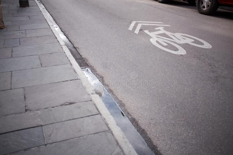 Painted bicycle sign on an asphalt street stock photography