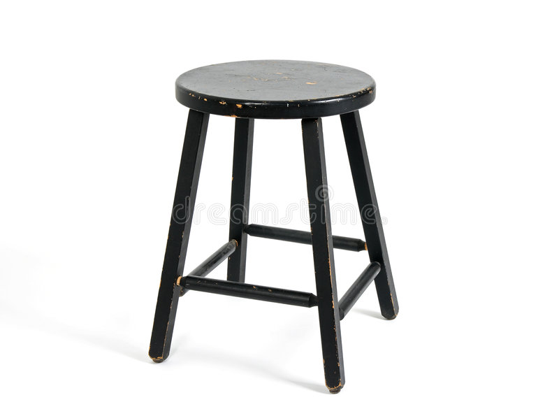 Painted black wooden stool royalty free stock photography