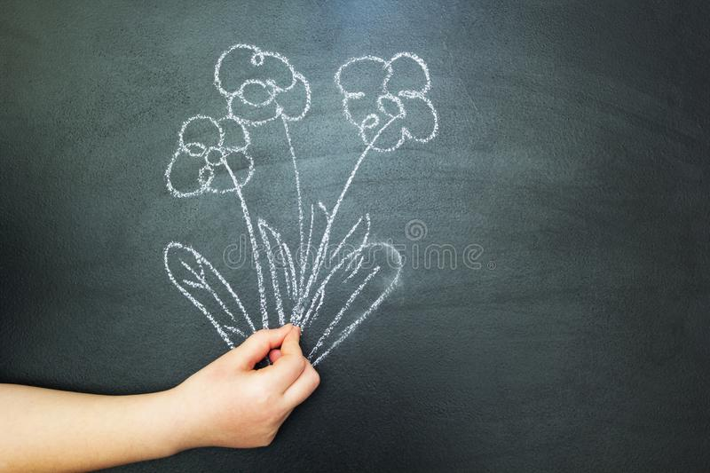 Painted bouquet in hand. Chalk drawing on blackboard stock illustration