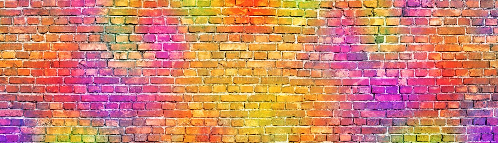 Painted brick wall, abstract background a diverse color stock image