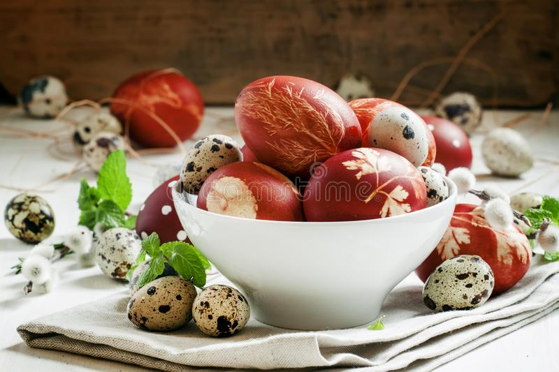 Painted brown Easter egg with a pattern, quail eggs, twigs of wi royalty free stock images