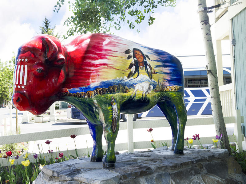 Painted Buffalo in Jackson Hole Wyoming. Jackson is a town located in the Jackson Hole Valley of Teton County, Wyoming, United States. The population was 8,647 stock images