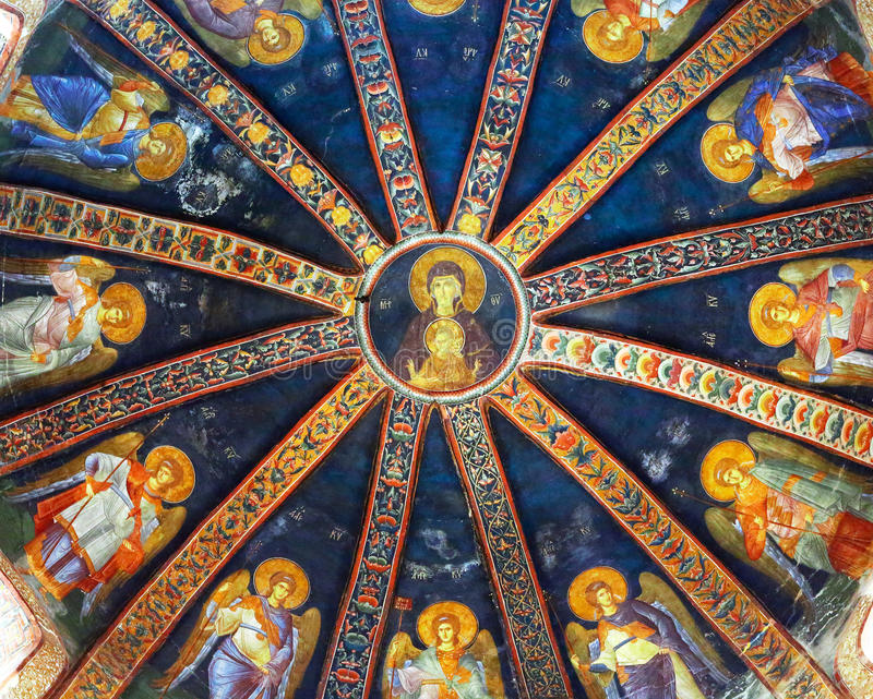 Painted ceiling of dome in Chora church, Istanbul. In the center Mary and baby Jesus royalty free stock images