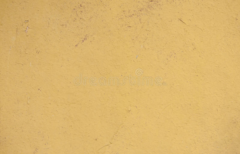 Painted chipboard. The yellow painted chipboard texture royalty free stock photo