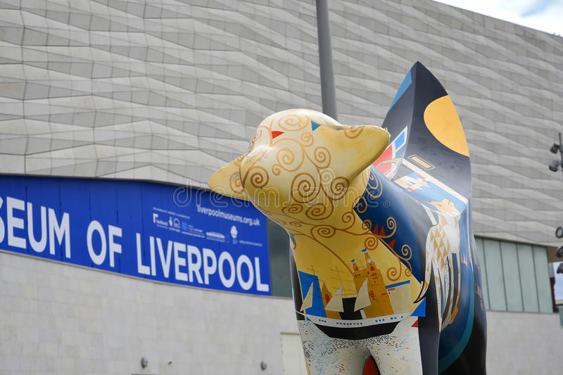 Painted Cow sculpture on Albert Dock in Liverpool Merseyside England. The Albert Dock is a complex of dock buildings and warehouses in Liverpool, England stock image