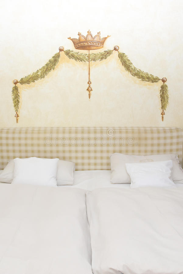Download Painted Crown And Garland Over Bed Stock Photo - Image: 33318484