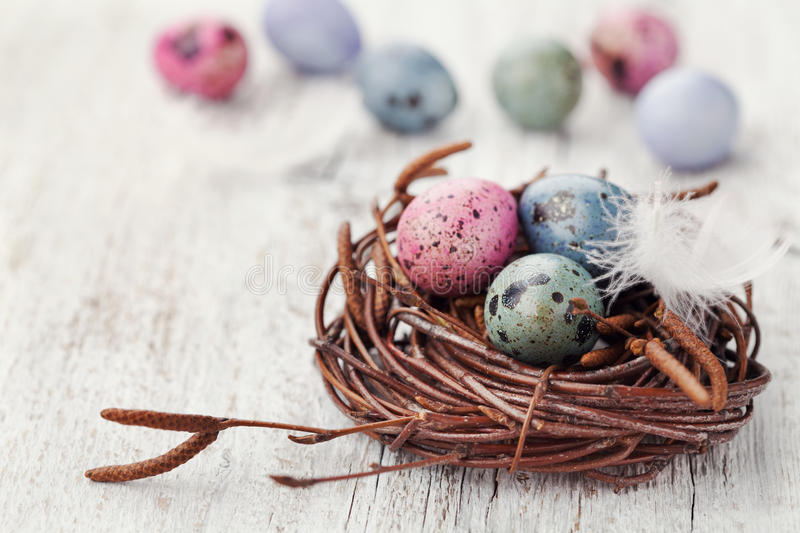 Painted easter eggs in nest on rustic wooden background vintage download painted easter eggs in nest on rustic wooden background vintage style stock image negle Gallery