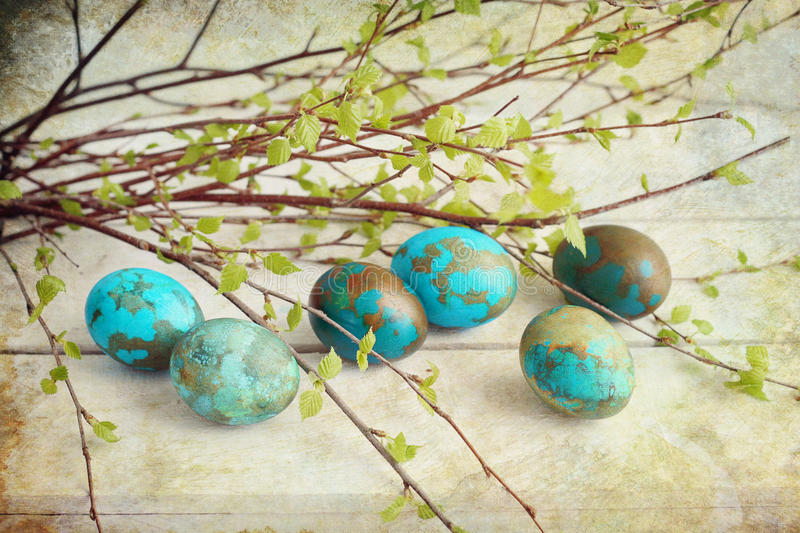 Painted eggs. Easter painted eggs with birch branches stock image