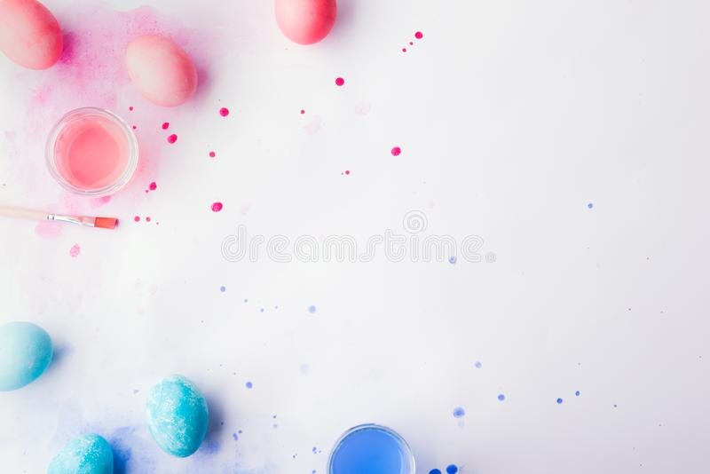 Eggs, paint and brush flat lay on a white background. Easter and spring composition. royalty free stock photos