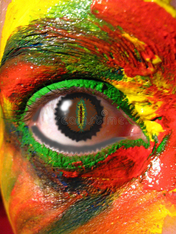 Painted Eye. Closeup colorful abstract of a multicolor painted face and colored eye
