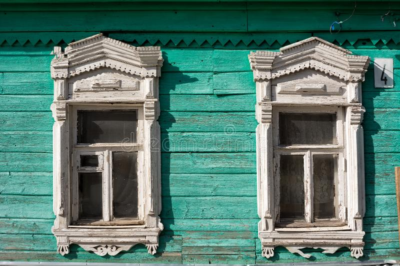 Painted facade of an old wooden house with decorative wood carving in the old town of Kolomna in Russia. Painted facade of a wooden house with decorative wood stock images