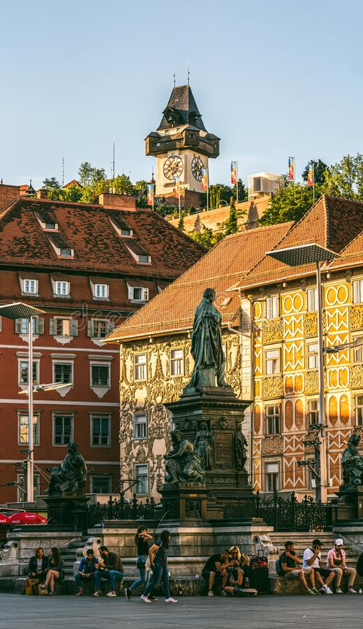 Painted facades and the Clock Tower in the old town of Graz, Austria stock photos