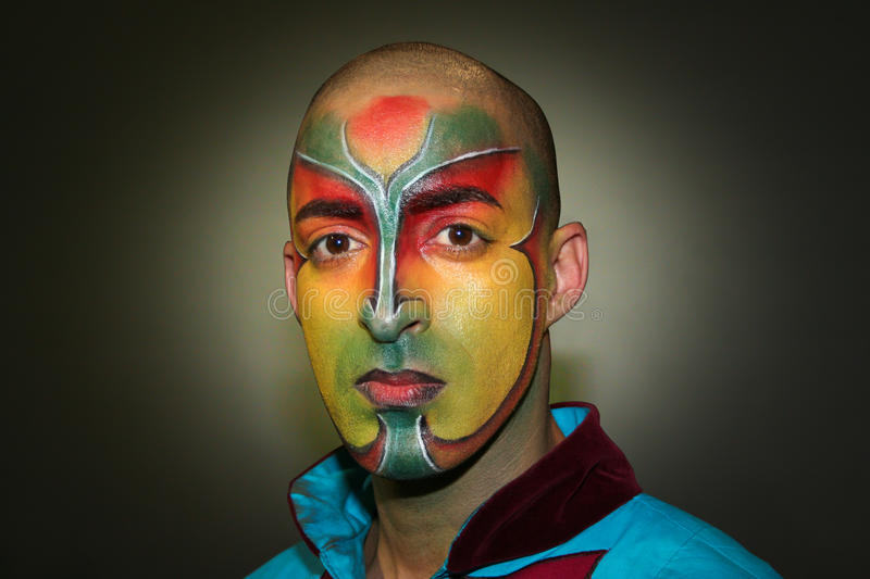 Painted face. Le Cirque du Soleil, performer. A performer of Le Cirque Du Soleil. The artist has painted face. Event: Presentation of the new Fiat Bravo (01/ stock images