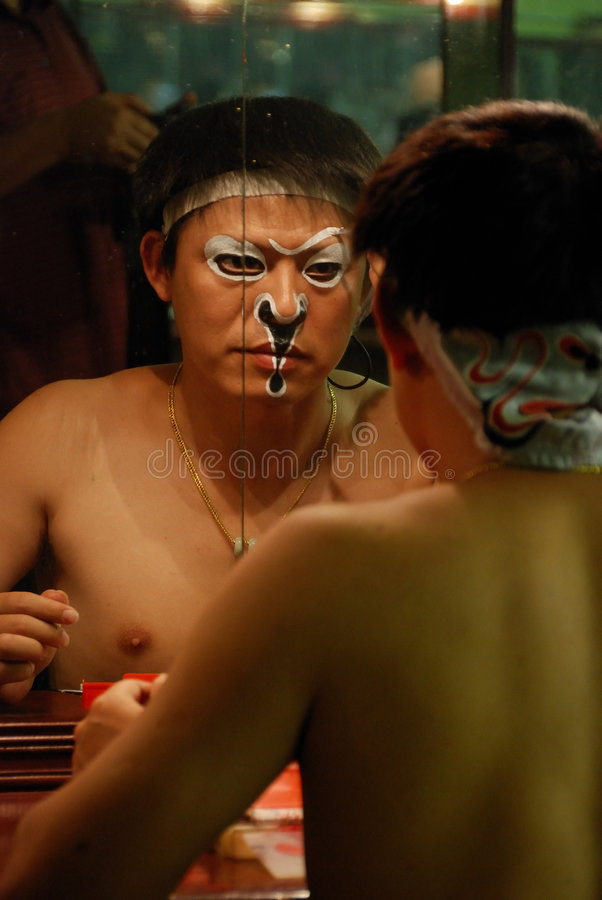 Painted-face in mirror stock photography