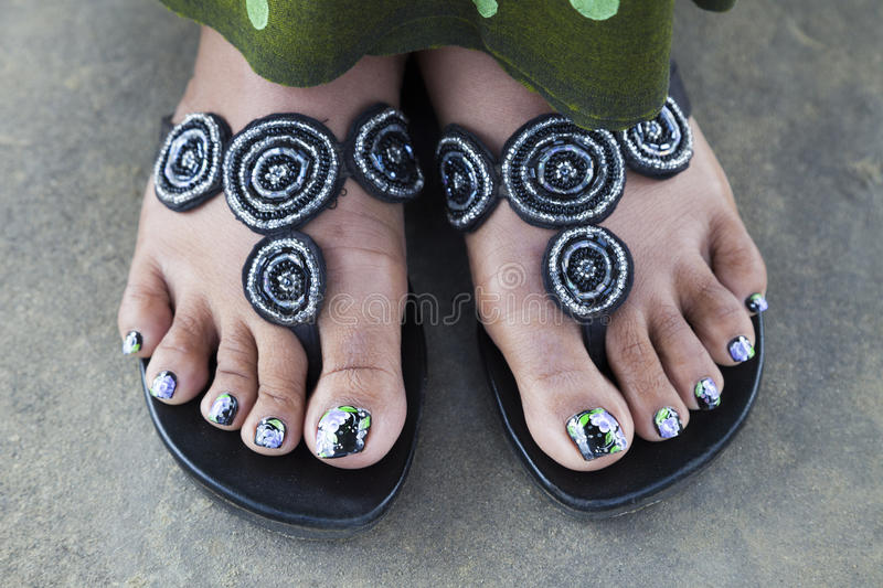 Black women feet in flip flops toenails opinion