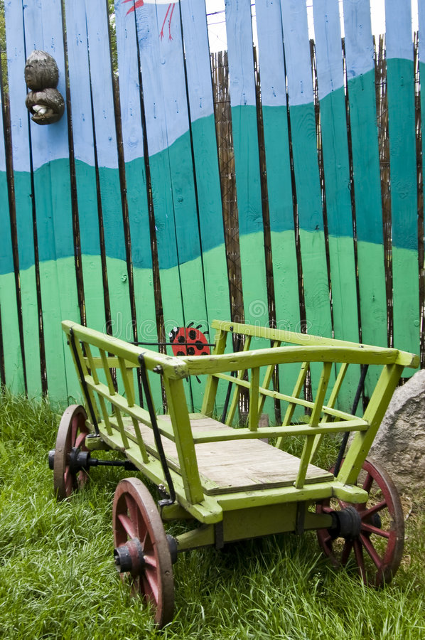 Painted fence with Hay-waggon. Painted fence with little Hay-waggon stock photos