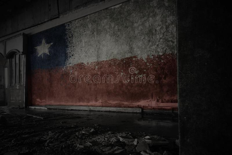 Painted flag of chile on the dirty old wall in an abandoned ruined house royalty free stock photos