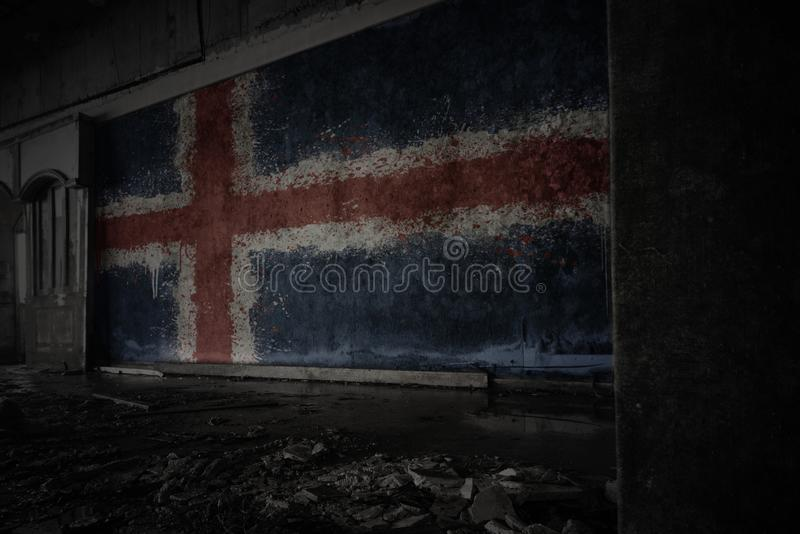 Painted flag of iceland on the dirty old wall in an abandoned ruined house royalty free stock photography