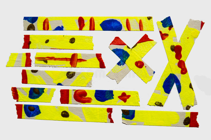 Painted Masking Tape. A set of yellow abstract-style painted masking tape pieces royalty free stock images
