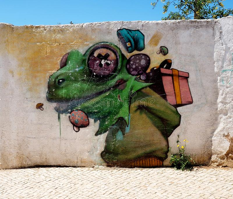 Painted Mural Of A Large Green Frog In Lagos Portugal royalty free stock photography