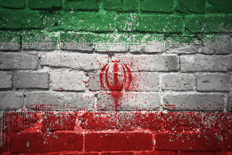 Painted national flag of iran on a brick wall. Colorful painted national flag of iran on a old brick wall stock photos
