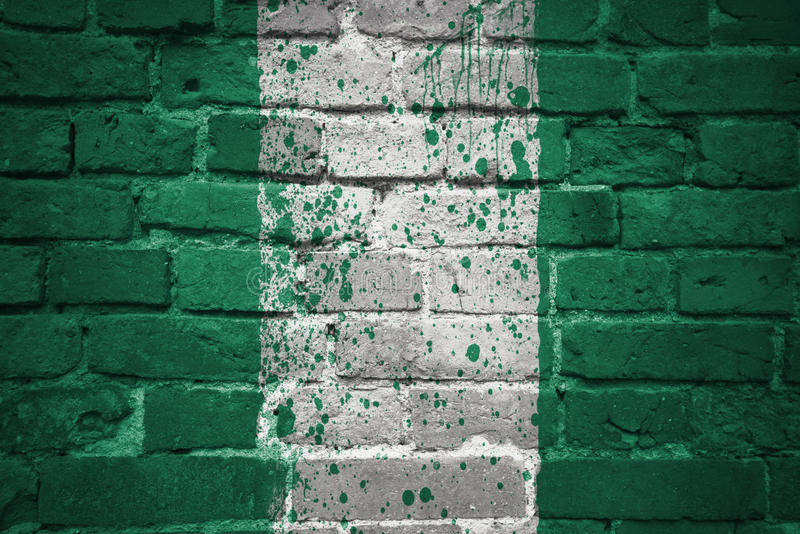 Painted national flag of nigeria on a brick wall. Colorful painted national flag of nigeria on a old brick wall stock photo