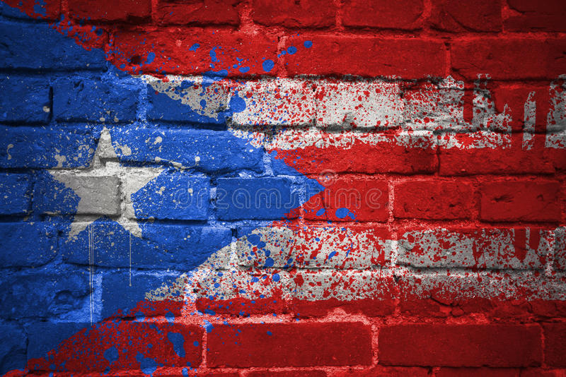 Painted national flag of puerto rico on a brick wall royalty free stock photos