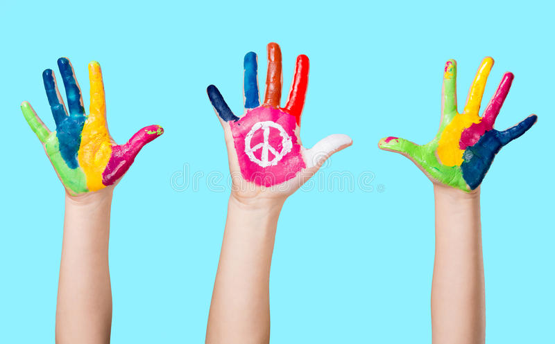 Painted peace sign in girl's hand against war. stock image
