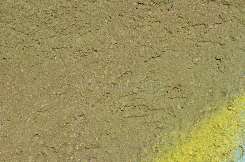 Painted plaster texture. Rough plastered wall airbrushed with green and yellow paint stock images