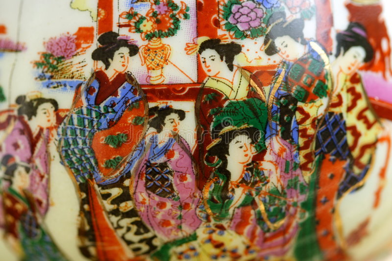 Painted porcelain. Porcelain cup hand painted with japanese scene with geisha - close-up stock images