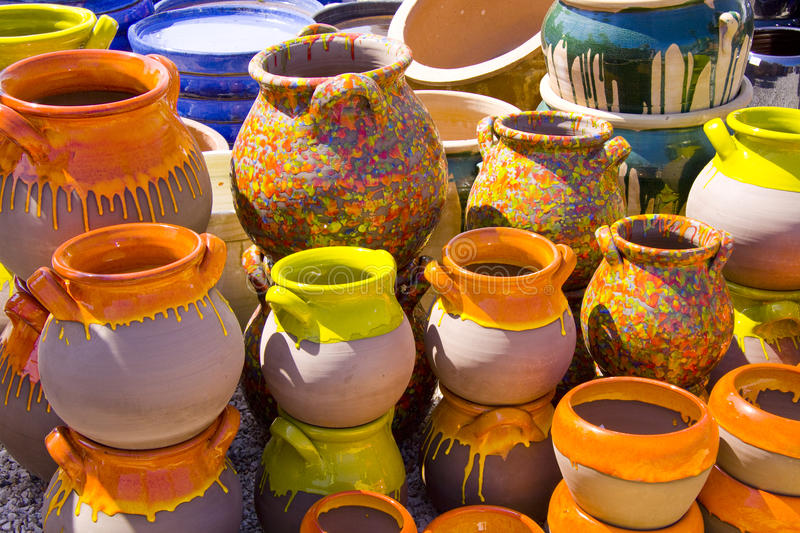 Painted pots. Lots of ceramic jars in different colors royalty free stock image