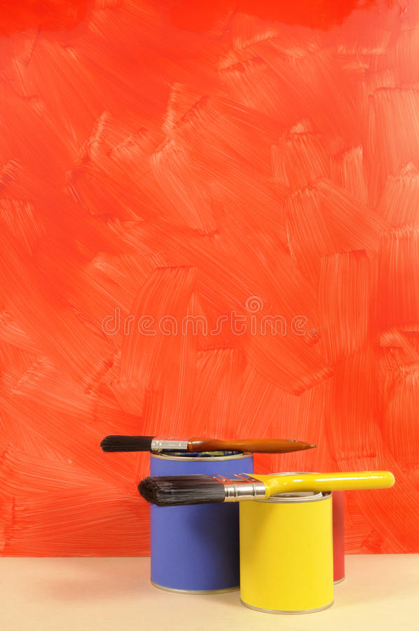 Blank painted red wall with paint cans and painbrush, home decorating concept, copy space, vertical stock photo
