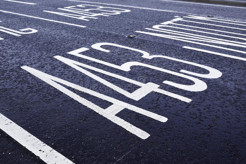 Painted road markings on Tarmac surface stock photos