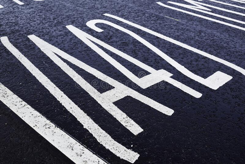 Painted road markings on Tarmac surface royalty free stock image