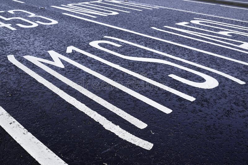 Painted road markings on Tarmac surface stock images
