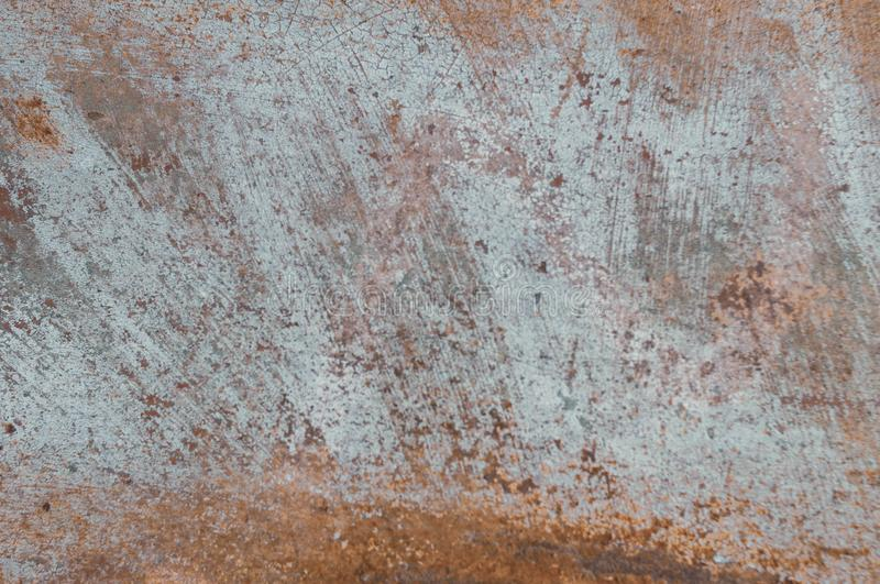 Painted scratched rusty grunde textured surface for background. Blue and orange painted scratched rusty grunde textured surface for background, banner and copy royalty free stock photo