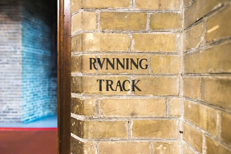 A painted sign indicating the entrance to a running track royalty free stock images