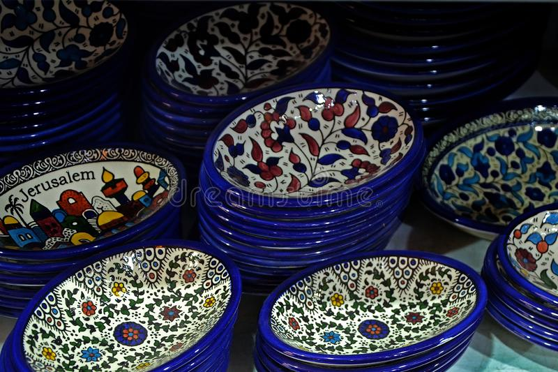 Painted souvenir plates on the counter in the store of Jerusalem, Israel. National ornament on a plate. Painted souvenir plates on the counter in the store of stock image