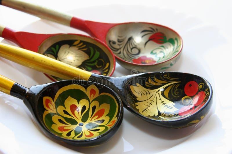 Painted souvenir spoons stock image